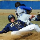 South Bend Riley's Hunter Knapp slides under Triton catcher Grant Stichter to score a run during Riley's 13-0 win at Triton Wednesday afternoon. (Photos by Mike Deak)