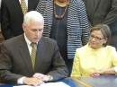Gov. Mike Pence signs Rep. Rebecca Kubacki's victims of domestic violence bill into law. (Photo provided)