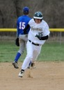 Wawasee's Lucas Garza speeds around the bases during a four-run third inning.