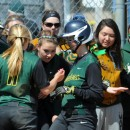 Wawasee's Alli Ousley, center, is mobbed by her teammates after hitting a home run in the seventh inning of Wawasee's 8-2 at Triton Saturday morning. (Photos by Mike Deak)
