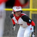 Samantha Johnson of Grace College works down the line from third base during action against Taylor University.