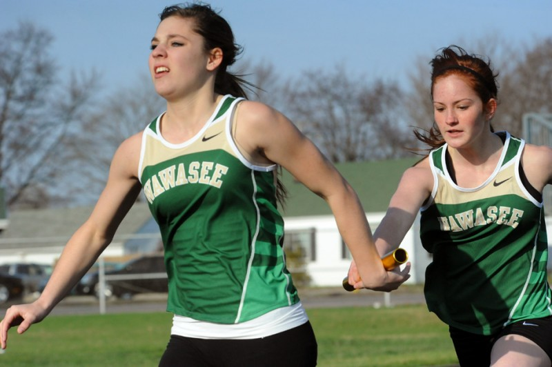 Wawasee's LeighAnn Shrack takes the baton from teammate Haleigh Smarr during the 4x100 relay against Goshen and Plymouth Wednesday evening. (Photos by Mike Deak)