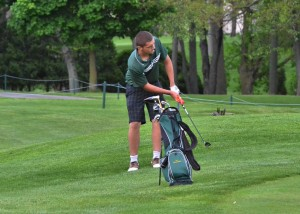 Cal Heinisch chips on to the No. 9 green at Bent Oak during Wawasee's match on Thursday night. (Photos by Nick Goralczyk)
