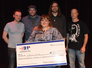 United members Renea Skaggs, Micah Gibson, Scott Hardy, Mike Beezley and Matt Leatherman with their $10,000 check for winning the People's Choice Award. (Photo by Deb Patterson)