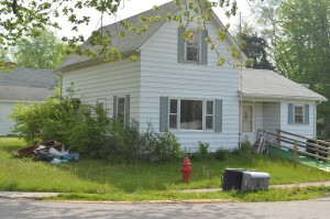 This shows the home of Gail Benson-Sauers on May 13, before neighbors began posting signs on her property. The town also sent a letter indicating a violation of the town's mowing ordinance. (Photo by Deb Patterson)