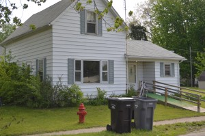Taken Tuesday morning, the home on North Mill Street, has had the yard mowed and signs removed, which were posted on the exterior by several individuals. (Photo by Deb Patterson)