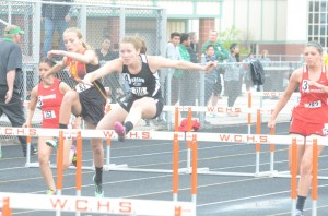 Jackie Ferguson was second in the 100 hurdles to help Warsaw win another conference championship.