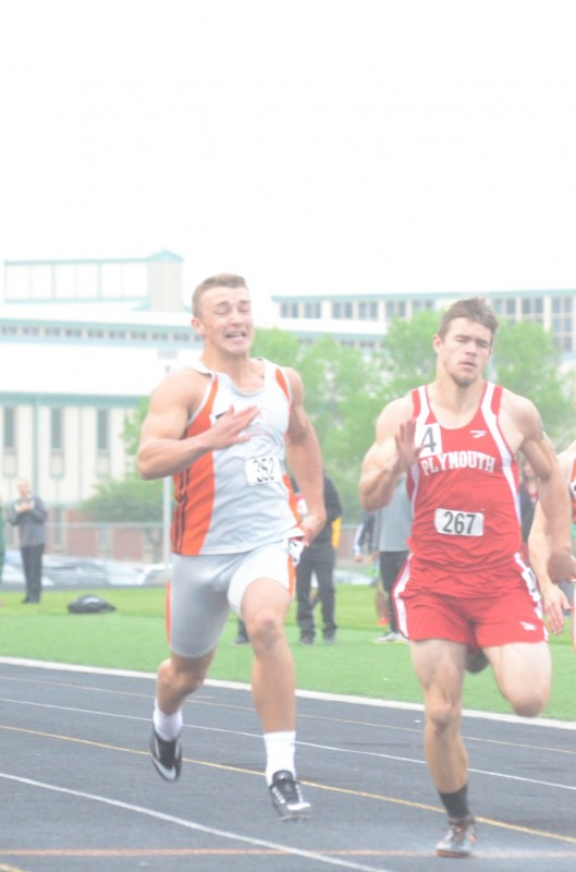 Michael Miller hits the finish line to win the 100 for champion Warsaw.