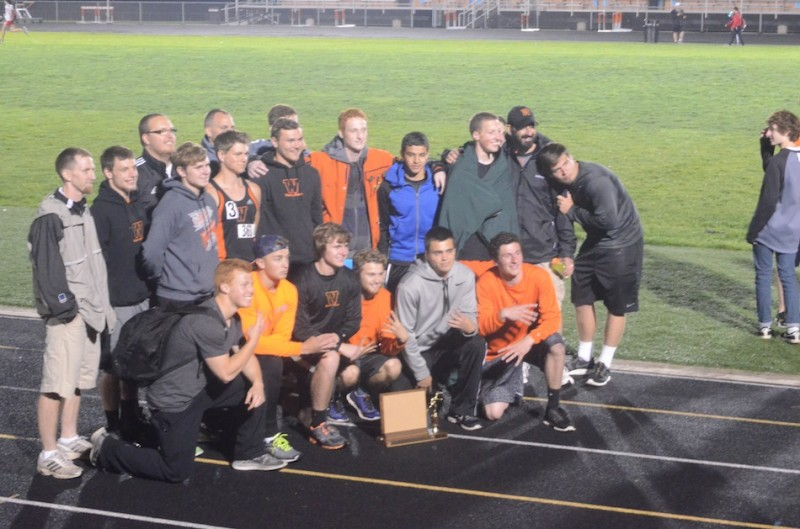 The senior members of the Warsaw boys track team are all smiles after winning the NLC Meet Tuesday night.