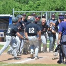 Dominic Miranda (12) is met at home plate after his grand slam.
