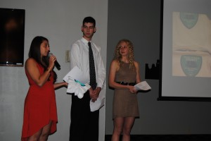 From left, Wawasee High School students Jada Antonides, Justin Ciriello and Courtney Linnemeier gave a presentation on their Project Proud May 7 at the Kosciusko Youth Leadership Academy banquet in Warsaw. They helped coach a Special Olympics basketball team this year.