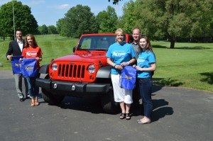 Shown with a 2013 Sport Wrangler Jeep that could be won with a hole in one on number 13 at Tippecanoe Lake Country Club are, from left, Ted Nine, owner of Warsaw Autoplex; Connie Geer, coordinator of the Boomerang Backpacks program for Wawasee schools; Tracey Akers, representing the Boomerang Backpacks program for Warsaw schools; Darren Parker, teacher in the Tippecanoe Valley School district and representing Boomerang Backpacks; and Joelle Schram, a junior at Warsaw Community High School who helps with the Boomerang Backpacks program. The second annual Boomerang Backpacks Golf Outing will be held June 16 at Tippecanoe Lake Country Club.