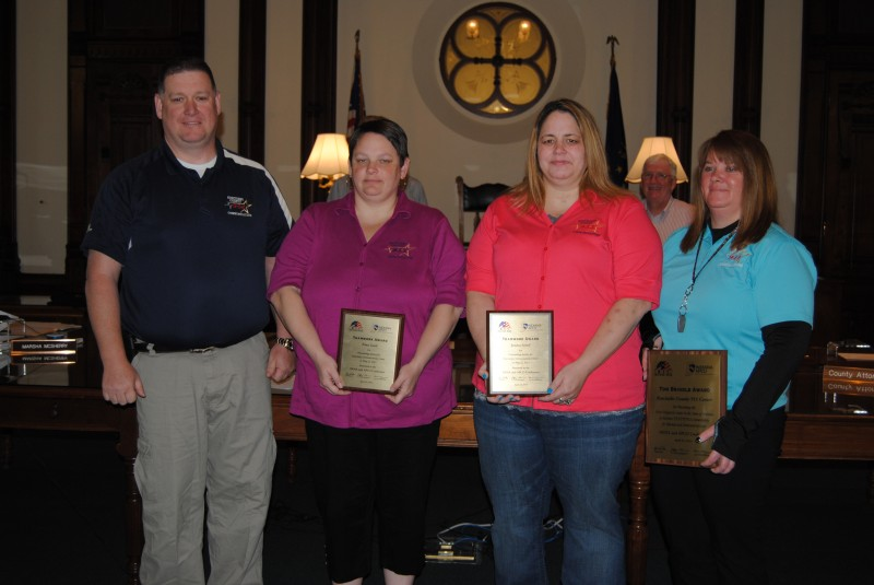 Several 911 dispatchers were honored at Monday's county commissioners meeting. The dispatchers were honored for their work when numerous school buses collided in North Webster in May 2013. Pictured, from left, are 911 Director David Rosenberry, Dispatcher Trina Gard, Dispatcher Jessica Scheil and Assistant 911 Director Sarah Lancaster. Not Pictured is Dispatcher Tina Cook.