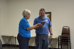Girl Scout Leader Barb Grumme, Troop No. 00148, presented Chad Jonsson, Syracuse park superintendent, with a community recognition award during the park board's regular monthly meeting Monday night.