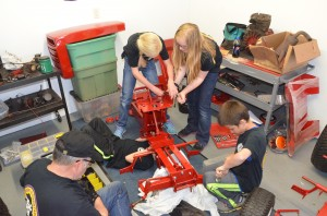 Students work on assembling the tractor they will sell to a bidder in June.  (Photo by Alyssa Richardson)