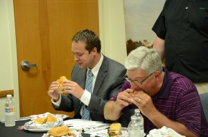David Hoffert and Joe Thallemer enjoy burgers together as they work to determine which of the top four burgers has their votes.  (Photo by Alyssa Richardson)