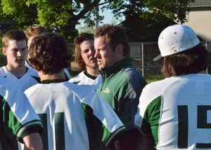 Brent Doty congratulates his team during a post game pow wow.