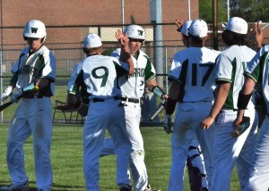 Drew Wright (27) is congratulated by teammates after scoring the tying run in Friday's ball game. (Photos by Nick Goralczyk)