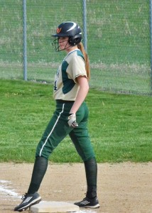 Kayleigh Rhodes gets ready to run at first after getting a hit in the junior varsity game.