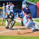 Dalton Schmidt gets tagged out by Seth Patrick in the top of the third inning.