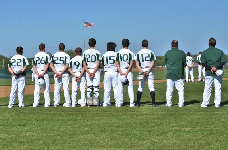 Wawasee stands ready for the first pitch during the playing of the national anthem.