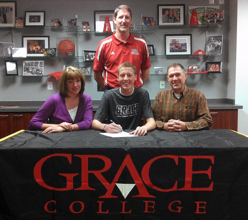 WCHS senior Tyler Houvener will continue his running career at Grace College. Houvener is shown above with his parent Grace and James. In back is Grace College coach Jeff Raymond (Photo provided by Grace College Sports Information Department)