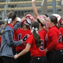 Grace College's softball team celebrates a solo home run by Brittany Melzoni Thursday during the NCCAA tournament game against Trinity Christian. Grace won the game 12-3. (Photo provided by the Grace College Sports Information Department)