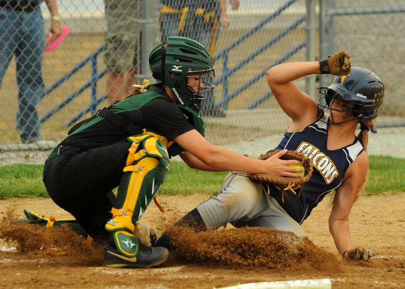 Wawasee catcher Paige Hlutke puts the tag on Fairfield's DJ Martz at home plate for an out during Wawasee's 5-2 win over Fairfield in the Fairfield Softball Sectional semi-finals Wednesday night. (Photos by Mike Deak)