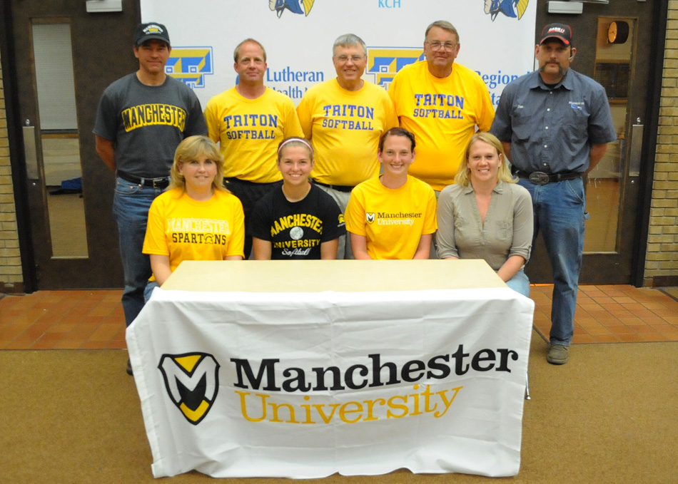 Triton High School softball players Mallorie Jennings and Allyson Brown have both verbally committed to continue their softball careers at Manchester University. In the front row, from left, are Stacy Jennings, Mallorie Jennings, Allyson Brown and Pamela Brown. In the back row are Scott Jennings, Triton assistant coach Jeff Mellott, Triton head coach Steve McBride, Triton assistant coach Bill Keyser and Daniel Brown. (Photo by Mike Deak)