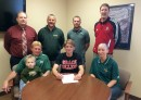 Wawasee senior Austin Yoder has chosen to continue his running career with Grace College. Pictured at the signing are, in front from left, father Gene Yoder, brother Easton Yoder, Austin Yoder, and mother Loretta Yoder. In the back row are WHS principal Mike Schmidt, Wawasee track coach Scott Lancaster, Wawasee cross country coach Doug Slabaugh and Grace College track and field coach Jeff Raymond. (Photo by Mike Deak)