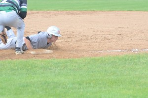 Sterlin Hay dives back into first base on a pickoff attempt.