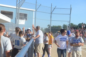 Mallorie Jennings is congratulated by her team after a home run.