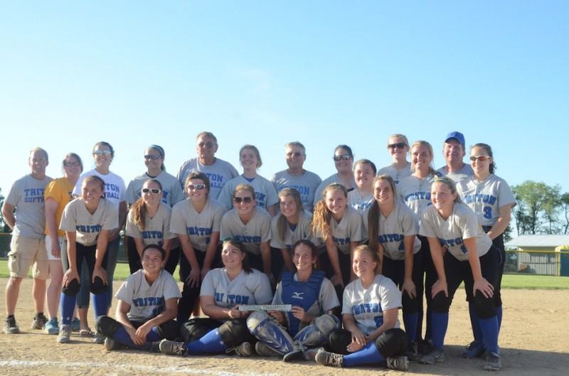 The Triton softball team is all smiles after winning a regional championship Tuesday night at South Central.