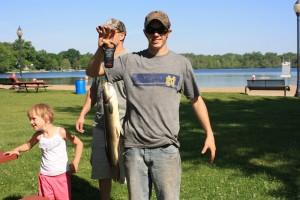 Dwayne Ohrt, grand prize winner in the Kids Fishing Derby, holds his winning 4 pound, 8 ounce Bowfin fish. (Photo provided)