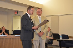 Dr. David Hoffert presents Dr. Craig Hintz with the Sagamore of the Wabash award.  (Photo by Alyssa Richardson)