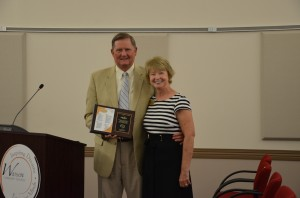Deb Blatz, director of special services, was honored for her 32 years of service with WCS by Dr. Craig Hintz. Blatz is retiring from the corporation effective June 30.  (Photo by Alyssa Richardson)