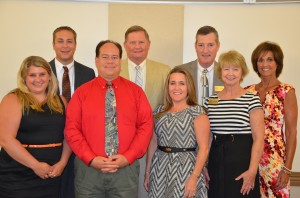 Dr. Craig Hintz Stands with his cabinent (from left) Nicole Wills, assistant to the superintendent; Dr. David Hoffert, Assistant Superintendent; Brad Hagg, chief technology officer; Dr. Craig Hintz, superintendent; Amy Sively, chief accountability officer; Kevin Scott, chief financial officer; Deb Blatz, director of special services; and Wendy Long, director of communications and language programs.  (Photo by Alyssa Richardson)