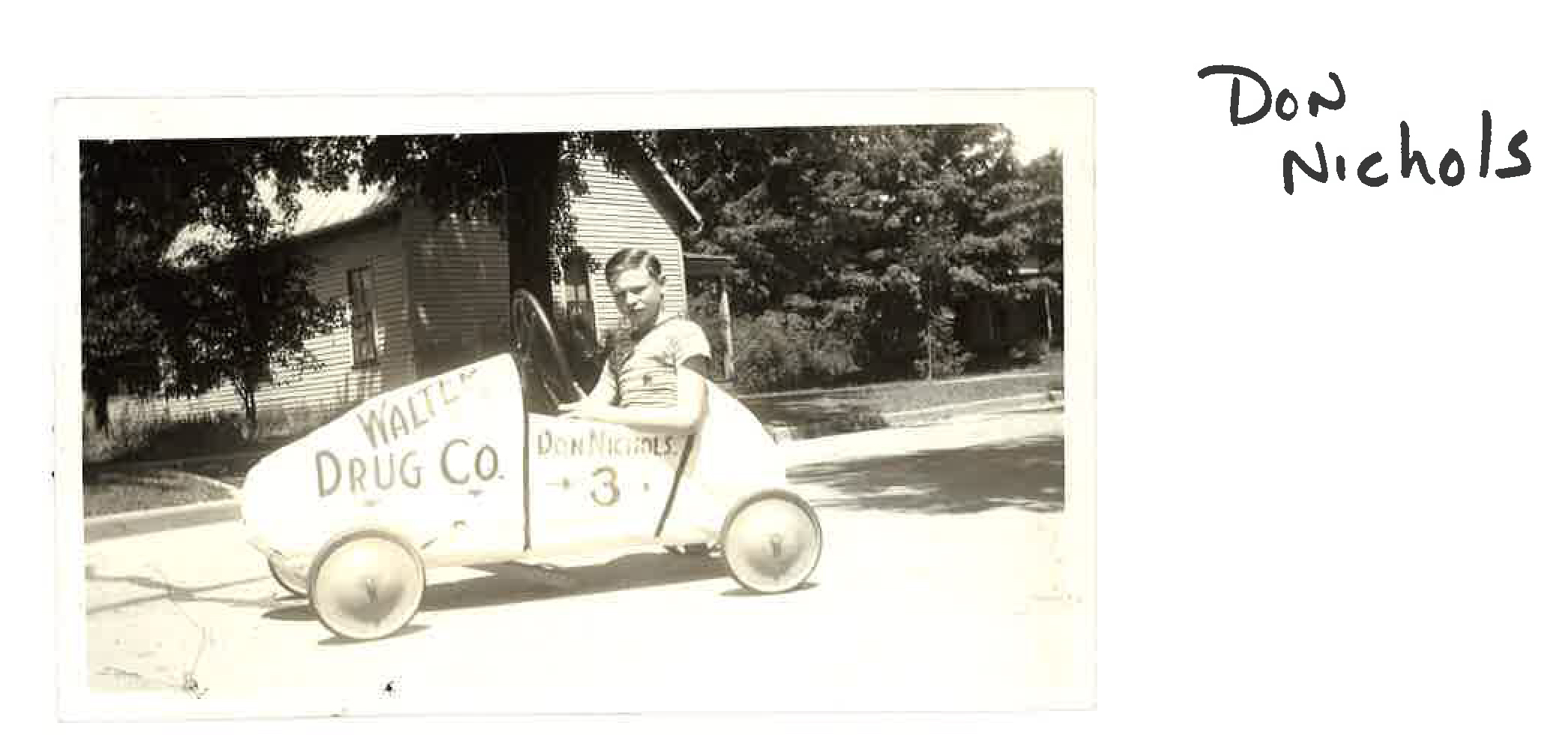 Don Nichols seated in his Soap Box Derby car.