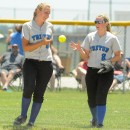 Triton outfielder Halie Zimmerman flips the ball to shortstop Krystal Sellers after Zimmerman made a snowcone catch.