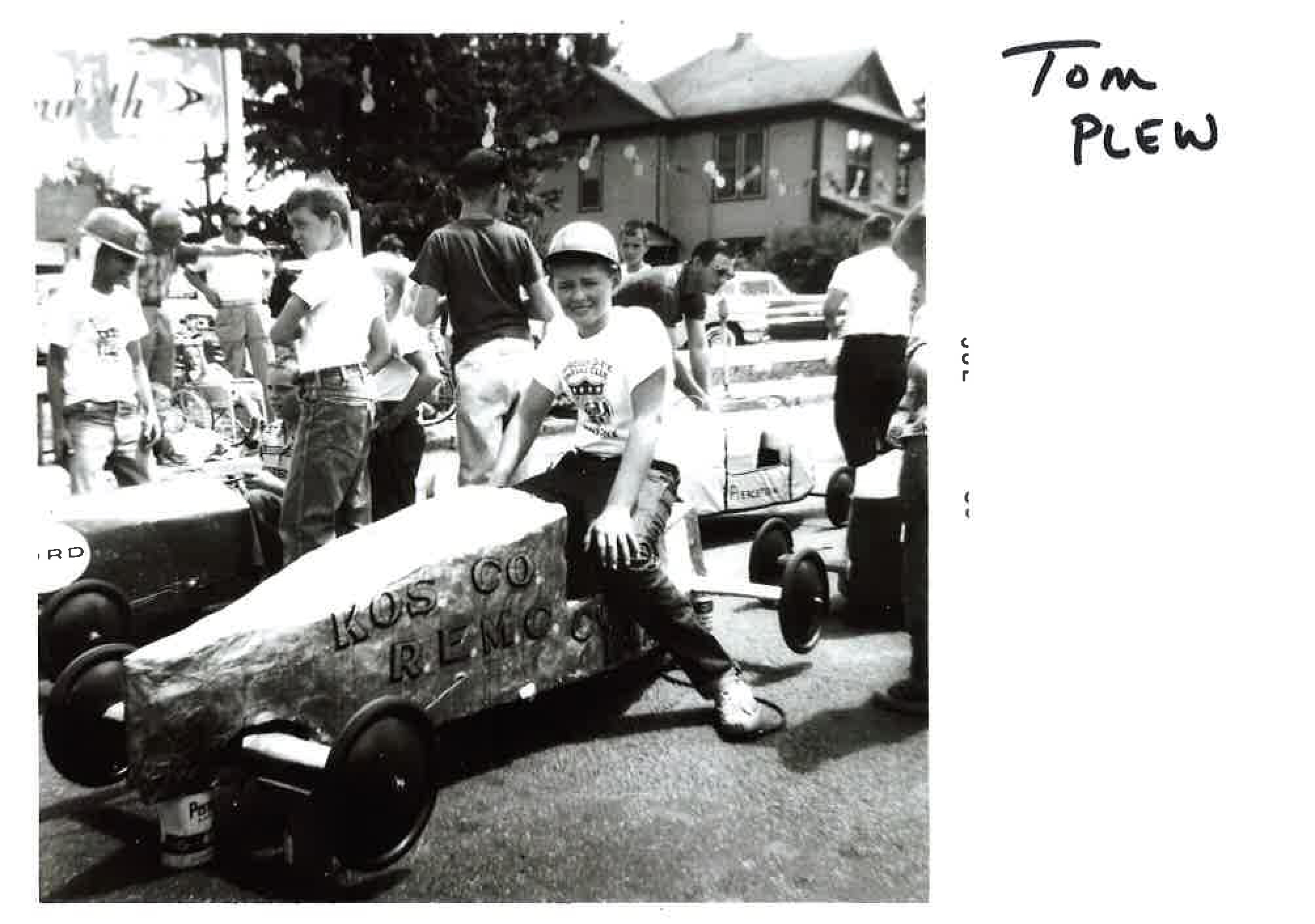 Tom Plew in soap box derby car.
