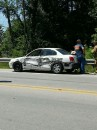 The driver of this car sideswiped a semi in Milford Friday noon. No injuries were reported. (Photo by Deb Patterson)