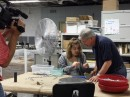 Cardinal's CCI employee, Audrey, shows Gordy Young how she inspects parts for Kilgore Mfg. You can see more on tonight's WNIT program, Experience Michiana. (Photo provided)