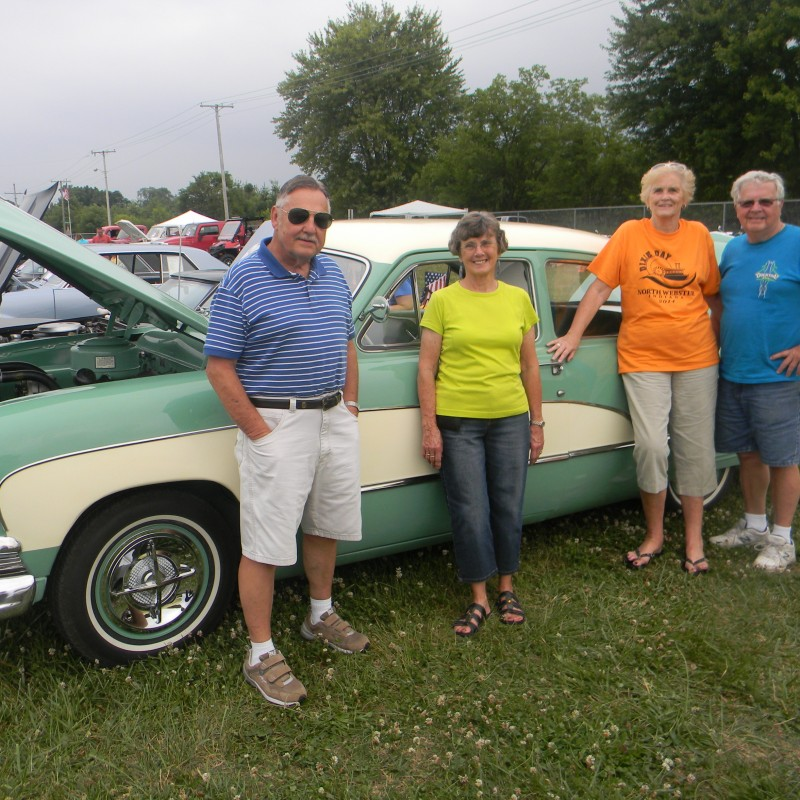 From left, Doug and Fran Bowser, Judy Capes and Jim Sample hang around Capes' and Sample's antique car before the winners are announced at the Mermaid Festival fairgrounds. (Photo by Andrea Yeater)