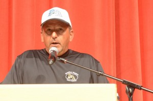 Karl Swihart addresses players, coaches and parents at Opening Ceremonies.