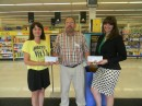 From left are Tracy May, coordinator of Wawasee High School's ECO Challenge; Dale Kovarik, Shopko store manager; and Stacey Anderson, development manager with CAPS.