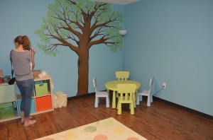 The kids' room, which has been adopted by donors and furnished, will allow children a play and study area of their own in the shelter.  (Photo by Alyssa Richardson)