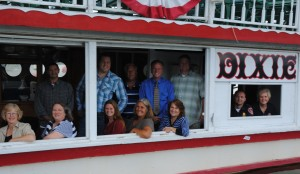 The hard working Dixie Day Committee of the North Webster-Tippecanoe Township Chamber of Commerce takes a brief break onboard the Dixie. From left to right, front row are Helen Leinbach, Jen Ducey, Kim Cantrell, Sue Ward, and Linda Land. In the window are Jeremy Likens and Karilyn Metcalf. In back are Chris Lusso, Ben Ashpole, Steve Ward, Richard Owen and Don Roulo. (Photo by Martha Stoelting)