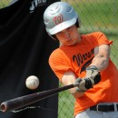 Warsaw's Bryce Sensibaugh takes a cut in the cage in preparation for the State Tournament.