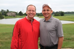 Crossroads League commissioner J.D. Collins golfed in the Grace Outing, taking time to pose with Grace College athletic director Chad Briscoe. (Photo by Josh Neuhart)