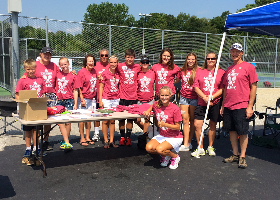 Warsaw Community High School senior Camille Kerlin, kneeling in front, is surrounded by her support team at the first running of the Racquets For Riley tennis event Saturday at WCHS. (Photo by Mike Deak)